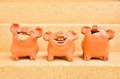 Trzy statui Świniowaty śmiech Zdjęcia Royalty Free