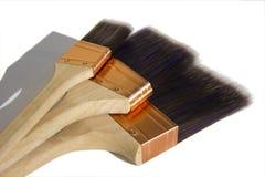 Trzy syntetycznego farby muśnięcia Zdjęcie Stock