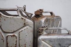 Trzy szarej puszki z benzyną lub olejem napędowym, metal baryłka obraz stock