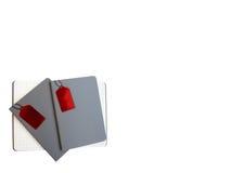 Trzy szarości zakrywają notatniki na białym tle, jeden są otwarci pod 2 zamkniętymi notatnikami, przy dolnym lewym kątem, kopiują Fotografia Stock