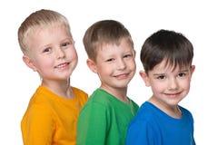Trzy szczęśliwej chłopiec zdjęcia stock