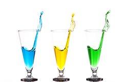 Trzy szkła z Kolorowymi pluśnięciami Fotografia Stock