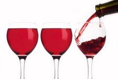 Trzy szkła z czerwonym winem Zdjęcia Royalty Free
