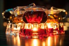 Trzy szklanego teapots z świeczka nagrzewaczami; Zdjęcia Stock