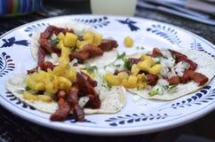 Trzy tacos al pastor na kukurydzanych tortillas Obrazy Royalty Free