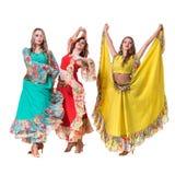 Trzy tancerzy żeński pozować, odizolowywam na bielu wewnątrz Fotografia Stock