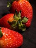 trzy truskawki. zdjęcia royalty free