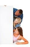 Trzy ucznia patrzeje placeholder Zdjęcia Stock