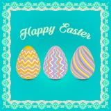 Trzy Wielkanocnego jajka na błękitnym tle Zdjęcia Stock