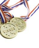 Trzy złocistego zwycięzcy medalu Obrazy Stock