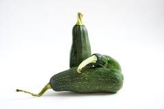 Trzy zucchini na biel Obrazy Stock