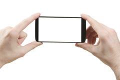 Trzymać eleganckiego mądrze telefon zdjęcia stock