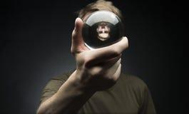 Trzymać kryształową kulę Zdjęcie Stock