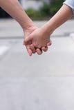 Trzymać ręki i opiekę Obrazy Stock