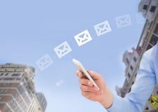 Trzymać telefon i email ikony blaknie w miasta niebie między budynkami Zdjęcia Stock