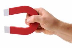 Trzymać magnes Zdjęcie Stock