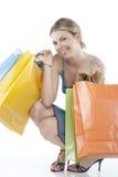 trzymający kilka shoppingbags kobiety młody obrazy stock