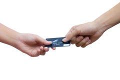 Trzymający kredytową kartę nad białym tłem i dawać Zdjęcie Royalty Free