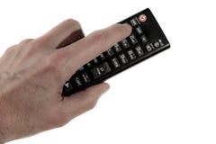 Trzymający remotecontrol ja lewa ręka zdjęcia royalty free