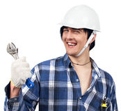 trzymający spanner uśmiechniętego pracownika młody Zdjęcie Stock