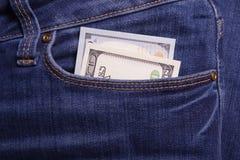 trzymaj ręce pieniądze Łapówka w biznesmenach kieszeniowych Dolary cur Fotografia Royalty Free