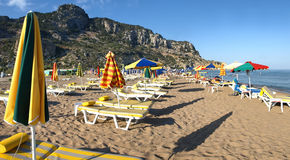 Tsambika beach. Famous sandy beach surrounded by mountains - the most popular tourist destination in Rhodes royalty free stock photo