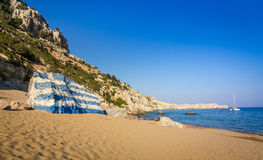 Tsambika beach landscape with Greece flag Royalty Free Stock Images
