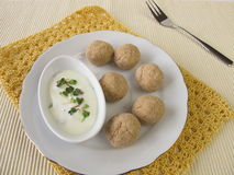 Tsampa balls with yogurt and radish sprouts Royalty Free Stock Image