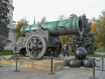Tsar Cannon Moscow. MOSCOW, RUSSIA - OCTOBER 20, 2012: Tourists visiting the Tsar Cannon monument in the Kremlin Stock Photography