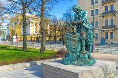 The Tsar Carpenter monument in St Petersburg. The Tsar Carpenter statue depicts young Peter the Great, creating the wooden ship, located at Admiralty embankment Stock Photography