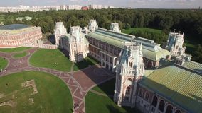 Tsaritsino palace in Moscow. Queen Ekaterina residence. Park garden architecture. Flight over. Sunny day. Aerial view stock footage