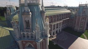 Tsaritsino palace in Moscow. Queen Ekaterina residence. Park garden architecture. Flight over Tsaritsino palace in Moscow Close approach. Aerial view stock video footage