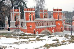 Tsaritsyno park in Moscow. Old bridge. White snow covers the ground. Stock Images