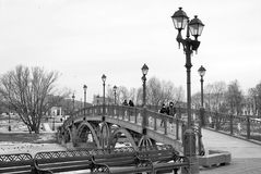 Tsaritsyno park in Moscow. People walk on the bridge. Royalty Free Stock Photography