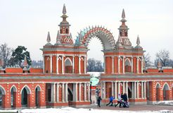 Tsaritsyno park in Moscow. People walk under the gates. Royalty Free Stock Photos