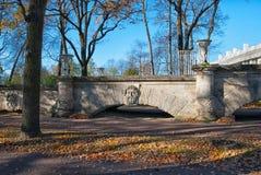 Tsarskoye Selo (Pushkin). Saint-Petersburg. Russia. The Catherine Park Ramp. TSARSKOYE SELO, SAINT - PETERSBURG, RUSSIA – OCTOBER 19, 2016: The Ramp with mask Royalty Free Stock Photo