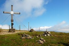 Tschiernock summit cross, Millstatt, Austria. Summit cross on Tschiernock Mountain with an edelweiss in a hiking area in austria, carinthia, millstatt Stock Photography