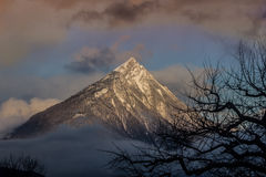 Tschirgant in imst, tyrol. Tschirgant in the rising mist in the twilight Royalty Free Stock Images