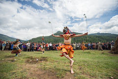 Tsechu mask dancing agains the sun at fire and smoke ceremony to cleans of sin in Thangbi Lakhang Royalty Free Stock Photos