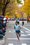 Tsegaye Kebede (Etiopía) funciona con el maratón de 2013 NYC Fotografía de archivo libre de regalías