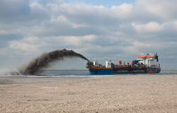 TSHD Utrecht Rainbowing. A Trailing suction hopper Dredger Rainbowing royalty free stock images
