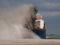 TSHD Utrecht Rainbowing. A Trailing suction hopper Dredger Rainbowing stock photo