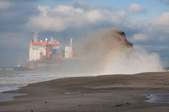 TSHD Utrecht Rainbowing. A Trailing suction hopper Dredger Rainbowing royalty free stock photos