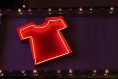 Tshirt neon lights. Shiny Tshirt sign neon lights Stock Images