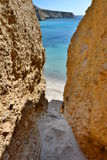 Tsigrado beach access. Milos. Cyclades islands. Greece Stock Photography