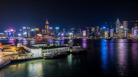 Tsim Sha Tsui Ferry Pier at Victoria Harbour stock video footage