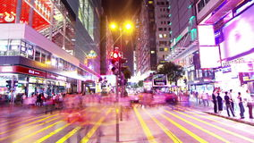 Tsim Sha Tsui. Hong Kong Night Timelapse. Tight Zooming out shot. Stock Photo