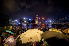 Crowded people waiting National Day Fireworks Display in rain at waterfront of Victoria Harbour of Hong Kong Royalty Free Stock Image