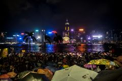 Crowded people waiting National Day Fireworks Display in rain at waterfront of Victoria Harbour of Hong Kong Stock Images