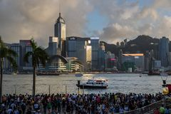 Crowded people waiting National Day Fireworks Display in rain at waterfront of Victoria Harbour of Hong Kong Royalty Free Stock Photos